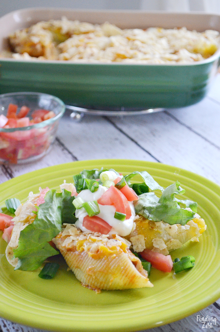 These taco stuffed shells are the answer to your dinnertime woes! Surprise family or guests with this unique take on stuffed shells by making stuffed taco pasta shells. This recipe will become a new family favorite!