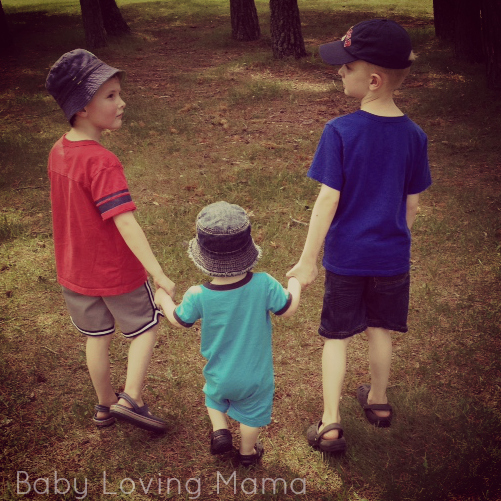 Brothers holding hands walking