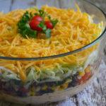 Fiesta Layer Dip with Corn Black Bean Salsa + Fish Tacos