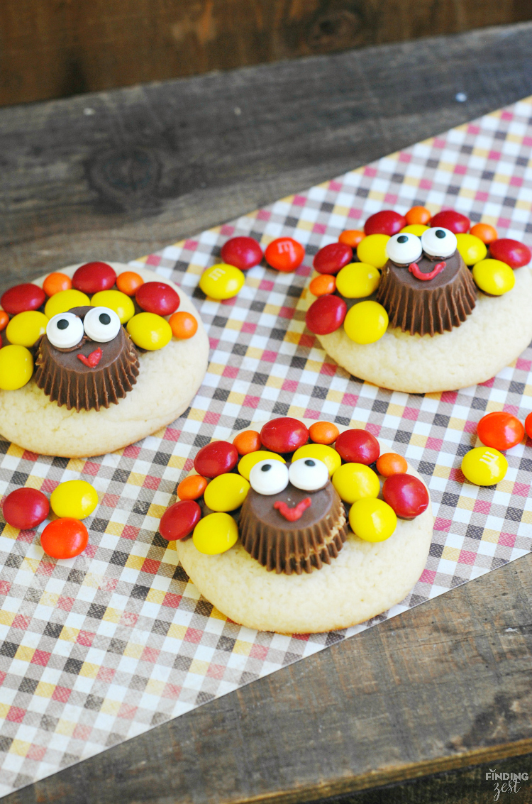 Check out these adorable turkey sugar cookies for Thanksgiving featuring peanut butter cups and chocolate candies. This is a perfect activity for kids and a great way to use leftover Halloween candy!