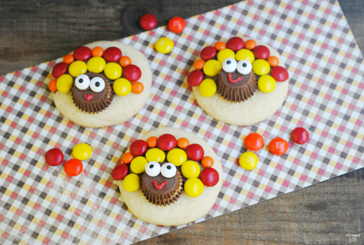 Check out these adorable turkey sugar cookies for Thanksgiving featuring peanut butter cups and chocolate candies. This is a perfect activity for kids and a great way to use leftover Halloween candy!!