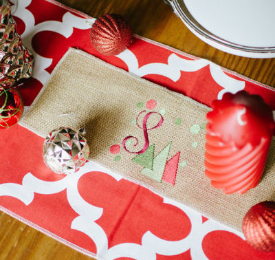 red quatrefoil table runner