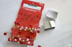 Supplies for homemade holiday napkins rings. Dollar store silver napkin rings and beaded garland