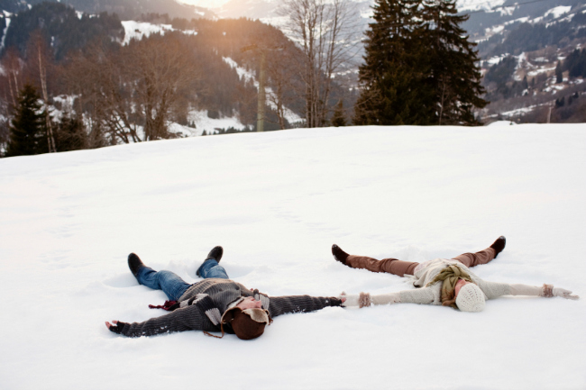Romantic Couple Making Snow Angels