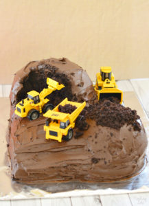 Make this easy construction cake using a chocolate cake mix with chocolate frosting and some toy vehicles. Super easy birthday cake idea for kids!