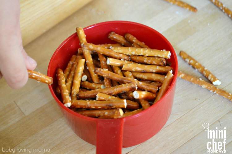 Breaking Up Pretzel Sticks for Almond Bark