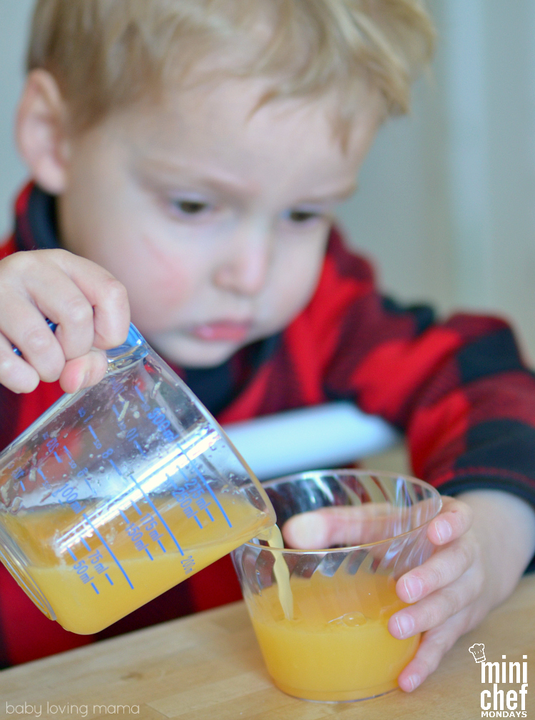 Three Year Old Pouring Punch