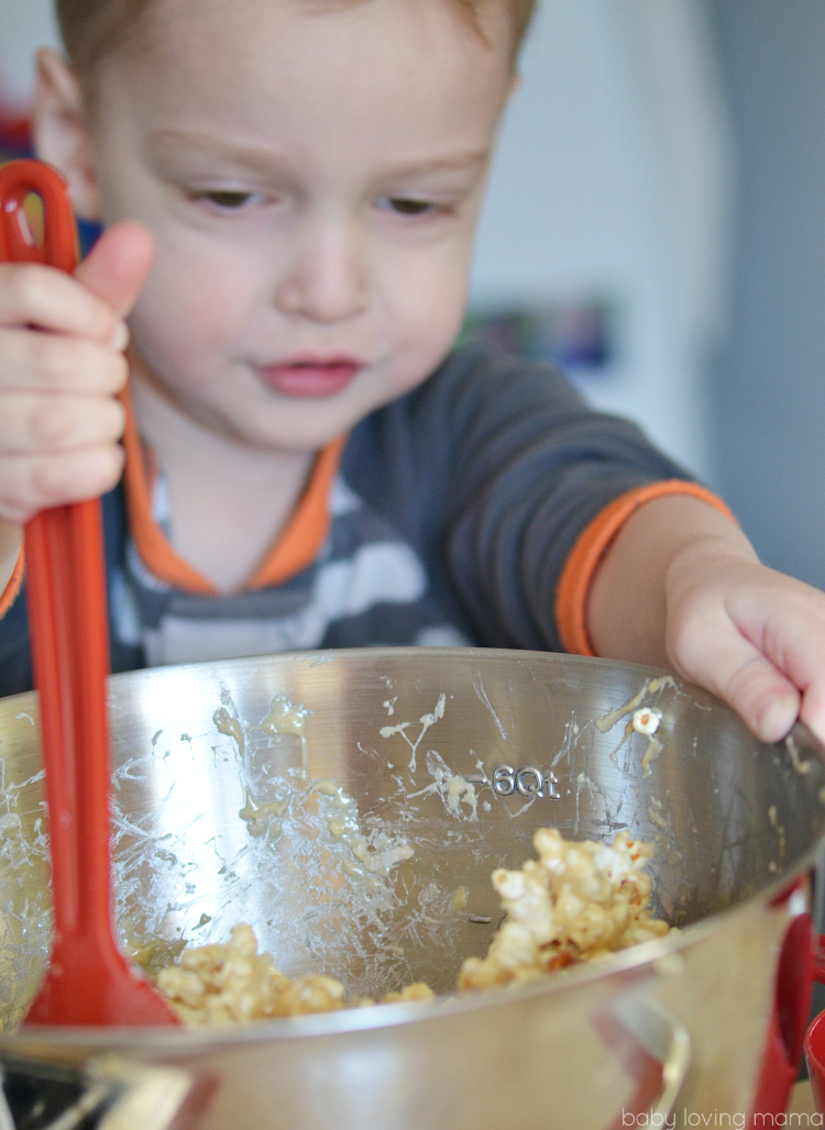 Kid Making Marshmallow Popcorn
