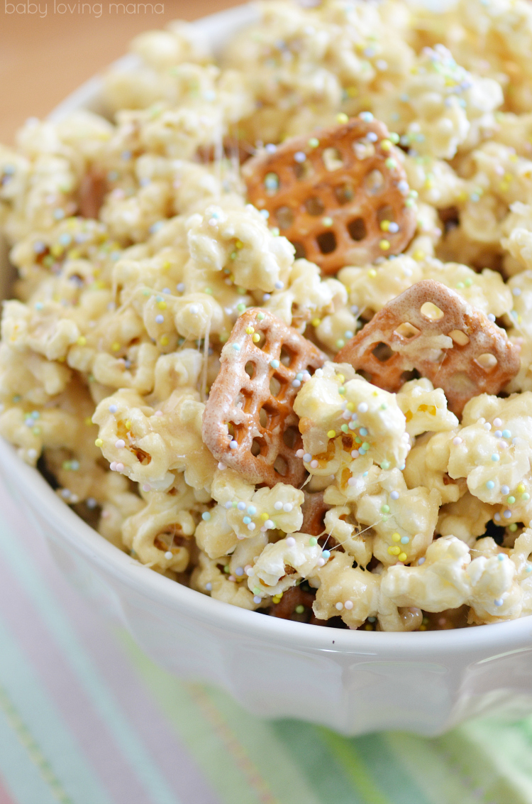 Spring Marshmallow Popcorn Recipe: Get over 75 great foods with sprinkles including fun party ideas, easy recipes, homemade, gluten free and more! Make every day feel like a party with these cakes, cupcakes, cookies, drinks, breakfast foods, snacks, frozen treats and more!