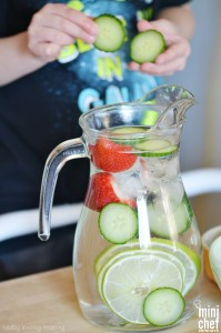 Child Making Strawberry Cucumber Lime Infused Water