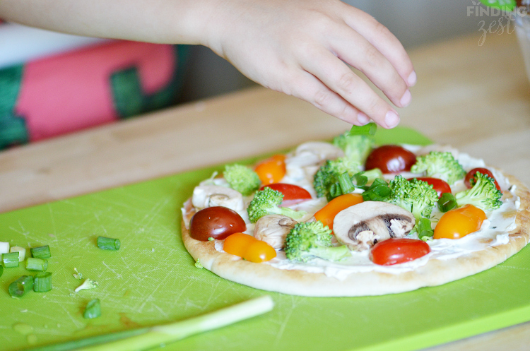 Adding Green Onion to Veggie Flatbread Appetizer