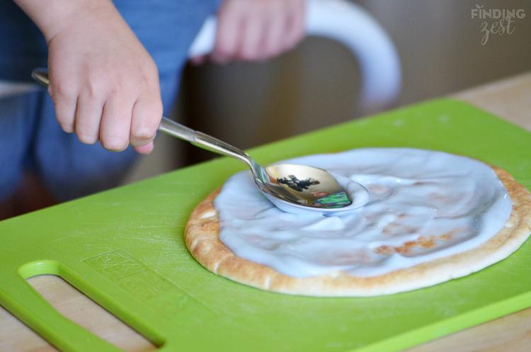 Spreading Yogurt on Breakfast Pizza
