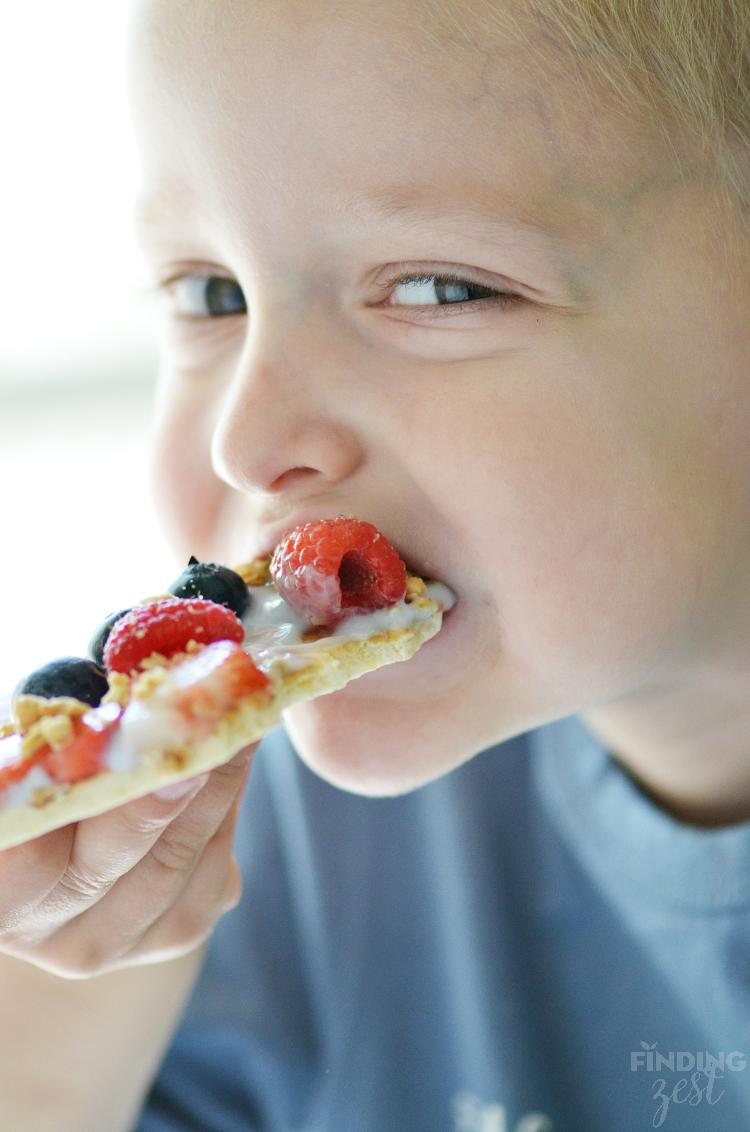 Wes Eating Fruit Yogurt Breakfast Pizza