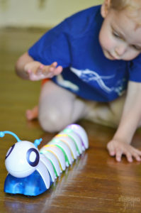Wes Playing with Fisher Price Code a Pillar