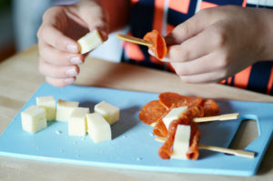 Kid Making Pizza Dippers for School Lunch