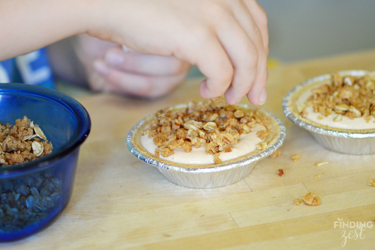 Adding Crumb Topping to Mini Pumpkin Pies