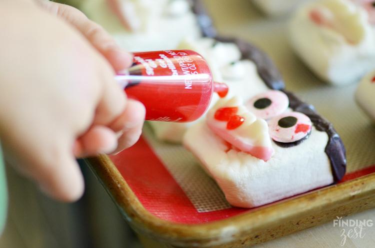 Adding Sparkle Gel Blood to Vampire Marshmallows