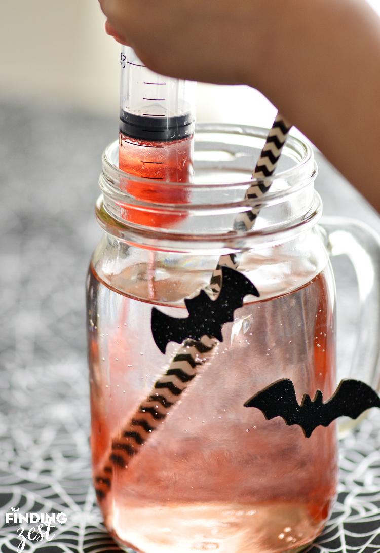 Using Syringe for Bloodshot Halloween Drink