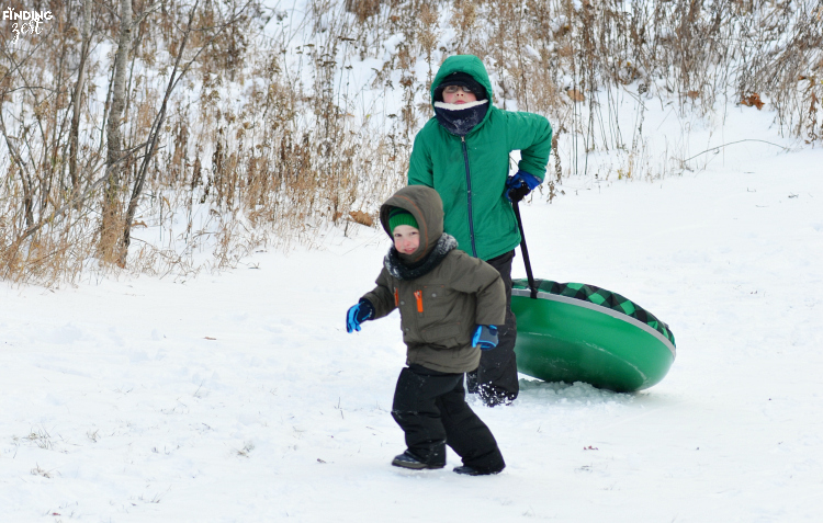 Kids Climbing Hill for Sledding