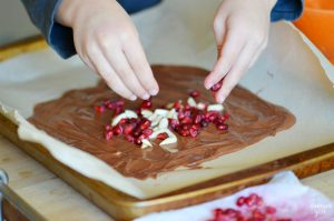 This Pomegranate Almond Chocolate Bark is a tasty holiday recipe featuring both white and milk chocolate, lightly toasted slivered almond and fresh pomegranates. This delicious combination of flavors is sure to impress!