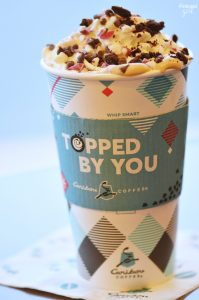 Enjoy Caribou Coffee this holiday season with this Merry Peppermint Mocha you can make at home, gift baskets ideas and Topped By You Tuesdays promotion.