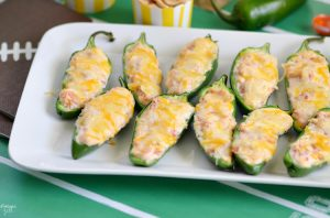 Win over the crowd with these Easy Stuffed Jalapeno Poppers. They are the perfect spicy game day snack with only five ingredients!