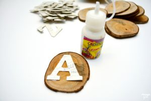 Make these DIY Wood Alphabet Learning Slices to teach your preschooler! Includes four learning activities to use with this simple wooden alphabet tool.