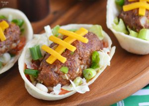 Make these Football Taco Boats for the big game! These football shaped taco meatballs are so flavorful and are perfect for tailgating at home.