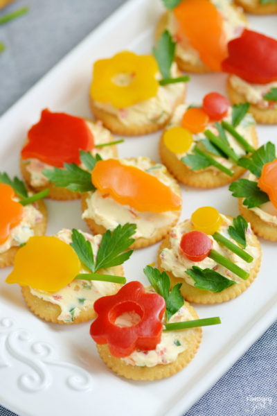 Make this easy spring appetizer featuring homemade veggie cream cheese, fresh herbs and vegetables and Ritz crackers for your next celebration such as Easter, Mother's Day or just because!