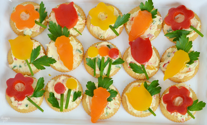 Make this easy spring appetizer featuring homemade veggie cream cheese, fresh herbs and vegetables and Ritz crackers for your next celebration such as Mother's Day, baby shower, wedding shower or just because!