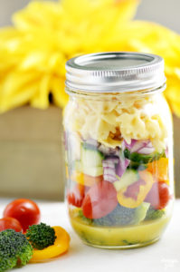 Serve up this easy to transport Mason Jar Pasta Salad to your next picnic or barbecue! It features a homemade tangy dressing, lots of veggies and pasta.