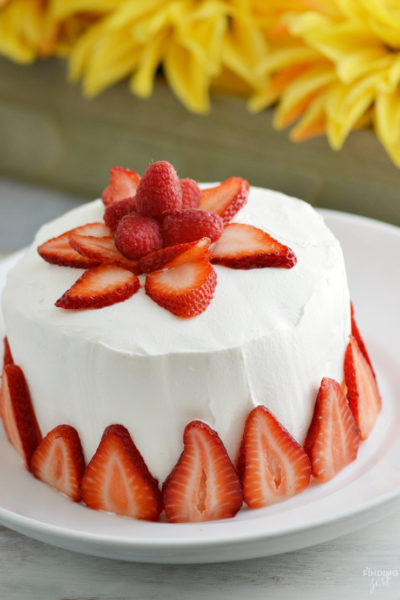 This Strawberry Jello Cake is literally made out of JELL-O! This two layer mock cake is easy and only uses 3 ingredients. No special mold needed! Perfect for those who don't like cake or have food allergies. Make it for your next celebration such as birthdays, Mother's Day, Easter or 4th of July!