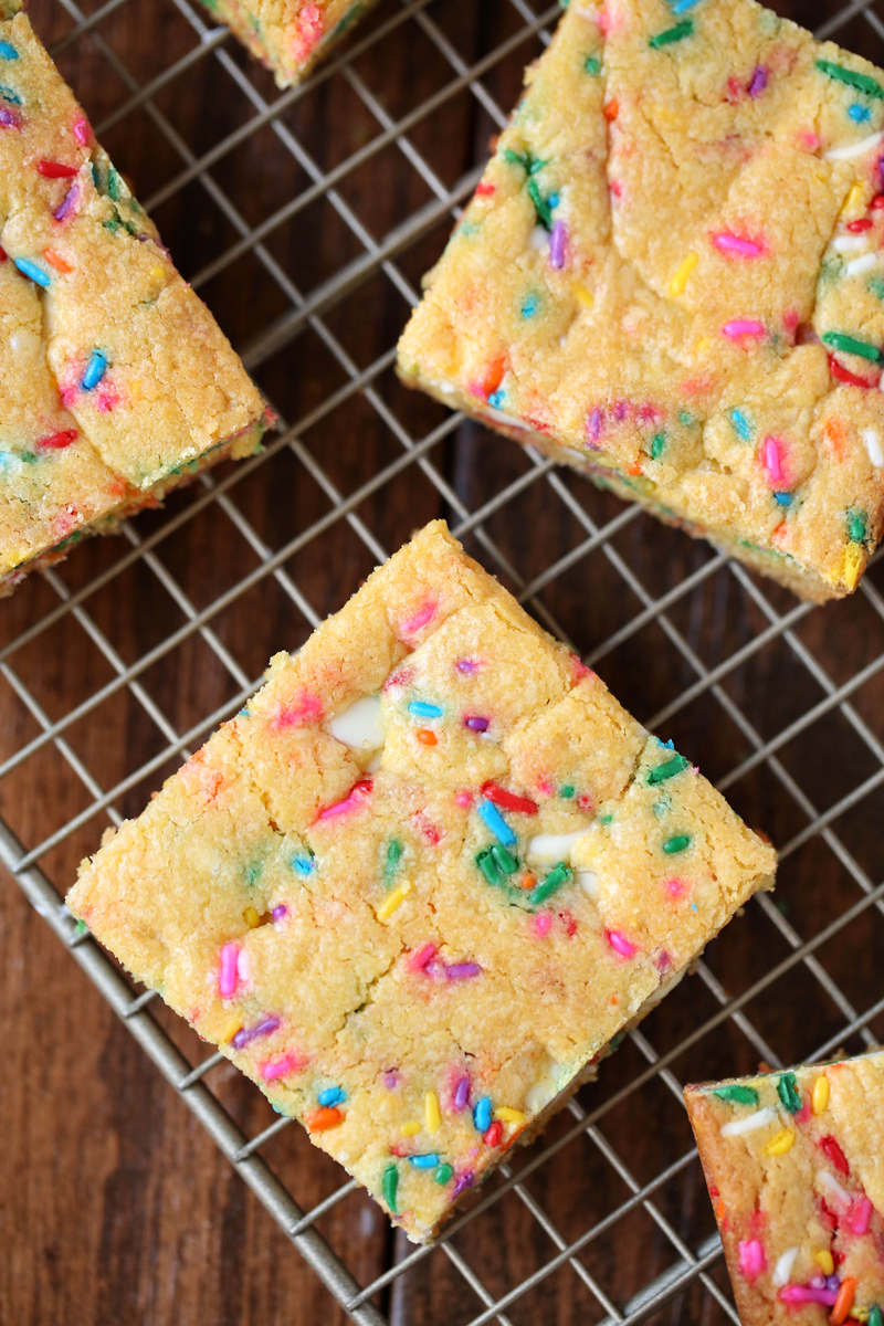 Confetti Bars: Get over 75 great foods with sprinkles including fun party ideas, easy recipes, homemade, gluten free and more! Make every day feel like a party with these cakes, cupcakes, cookies, drinks, breakfast foods, snacks, frozen treats and more!