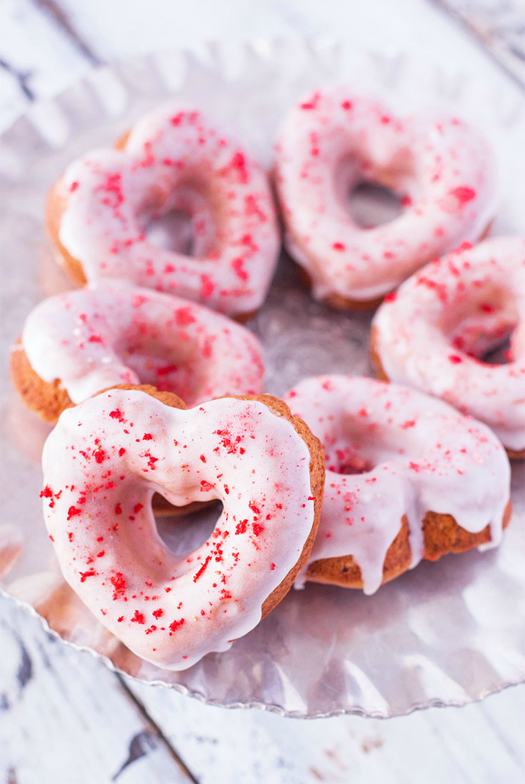 Strawberry Sprinkle Donut Hearts (Dye Free): Get over 75 great foods with sprinkles including fun party ideas, easy recipes, homemade, gluten free and more! Make every day feel like a party with these cakes, cupcakes, cookies, drinks, breakfast foods, snacks, frozen treats and more!