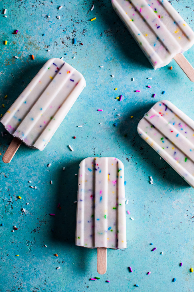 Vanilla Greek Yogurt Funfetti Popsicles: Get over 75 great foods with sprinkles including fun party ideas, easy recipes, homemade, gluten free and more! Make every day feel like a party with these cakes, cupcakes, cookies, drinks, breakfast foods, snacks, frozen treats and more!