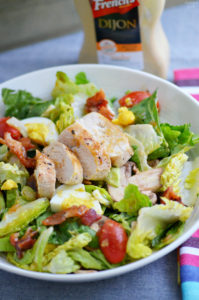 Try something new with this delicious warm chicken bacon salad topped with homemade mustard dressing! Loaded with fresh veggies and plenty of protein, it is a perfect salad for mustard lovers!