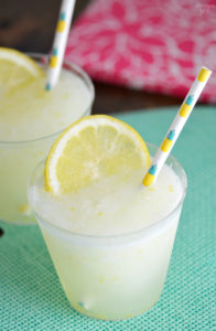 Beat the summer heat with this refreshing Homemade Frozen Lemonade recipe! Made with fresh lemons, this frothy drink is simple and delicious! Make this kid friendly drink at your next celebration.