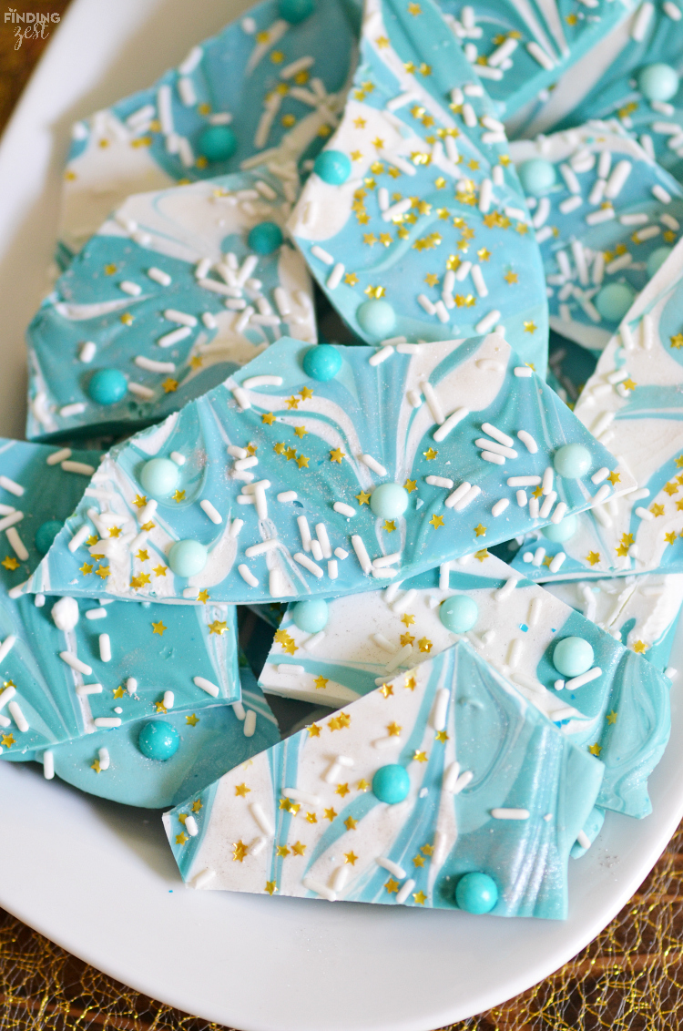Makes some waves with this mermaid party bark! Swirl chocolate to resemble ocean waves then top with sprinkles, gold stars and silver dust! Perfect for any ocean party celebrations. Kids will love it!