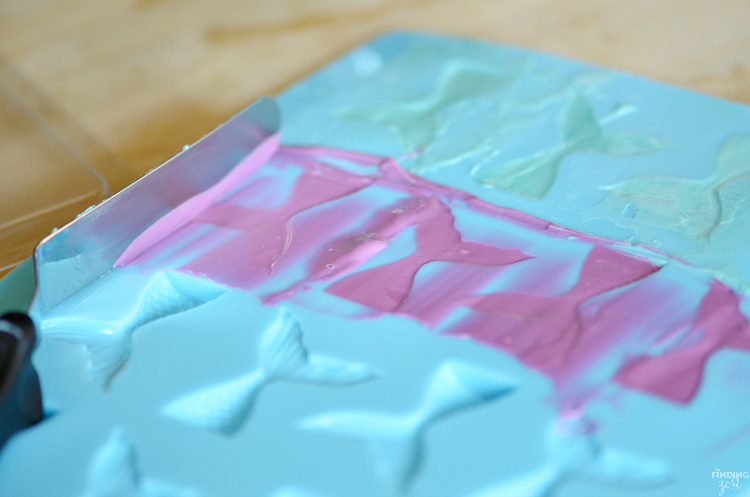 If you are searching for under the sea party ideas, look no further than these mermaid tail marshmallows! This no-bake treat features colorful chocolate mermaid tails and swirled chocolate waves. It is the perfect addition to any mermaid party or under the sea birthday themes!