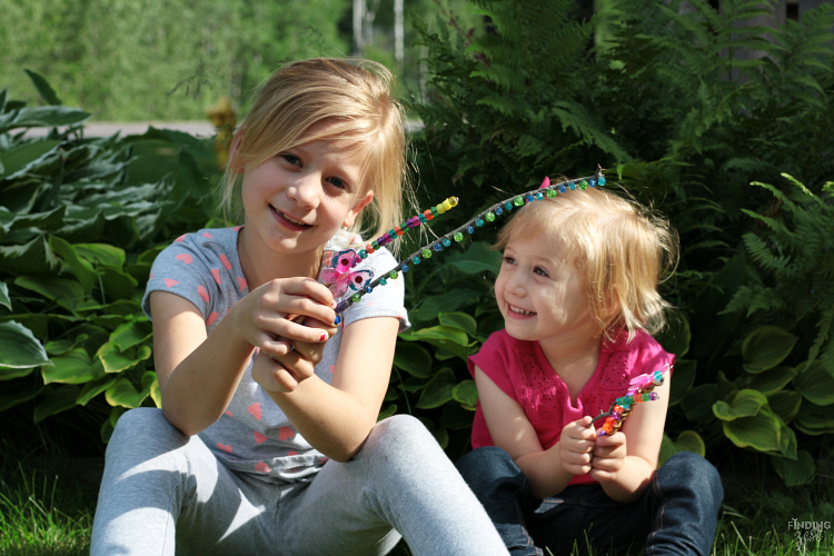 Friendship Wands are a fun kids activity and great for gift giving! This kids bead craft transforms sticks from your backyard into something unique and magical. Great for a rainy day and promotes fine motor skills, creativity and imagination!