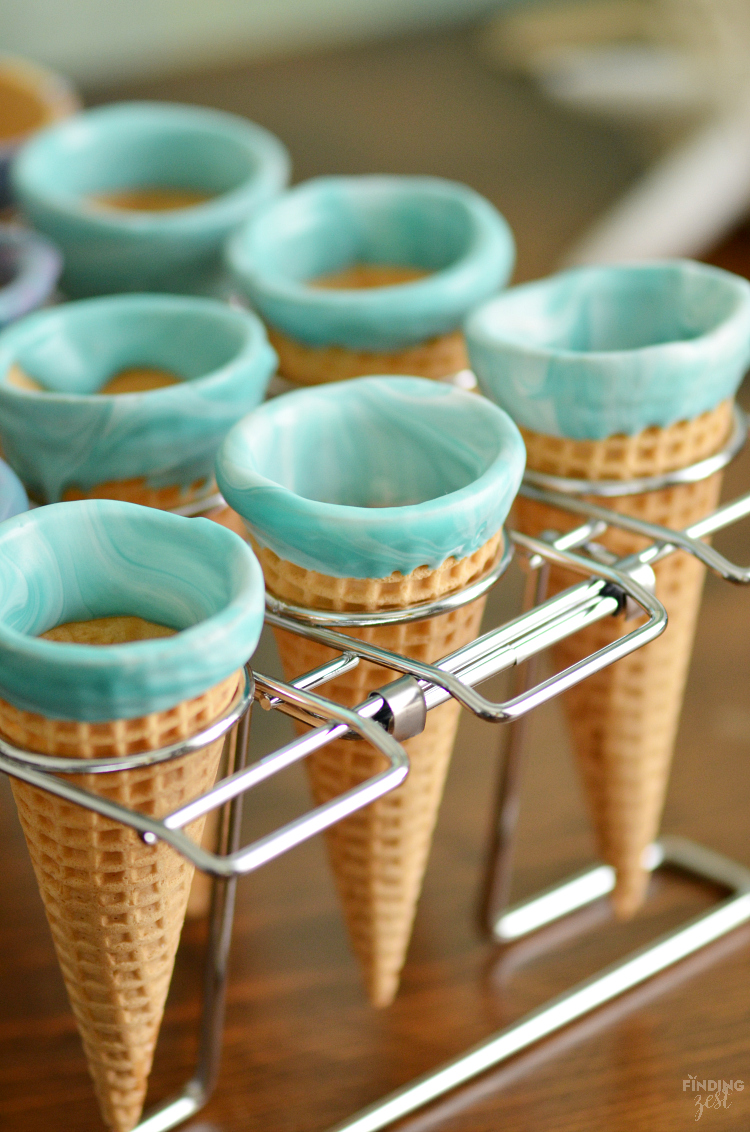 Kick dessert up a notch with these sparkling mermaid ice cream cones! Kids will love these chocolate dipped cones. Perfect for a mermaid or frozen themed birthday party!