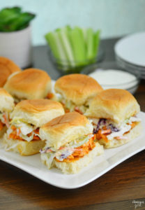 These easy Buffalo Chicken Sliders with rotisserie chicken and slaw topping on Hawaiian rolls make a tasty lunch or appetizer, perfect for game day!