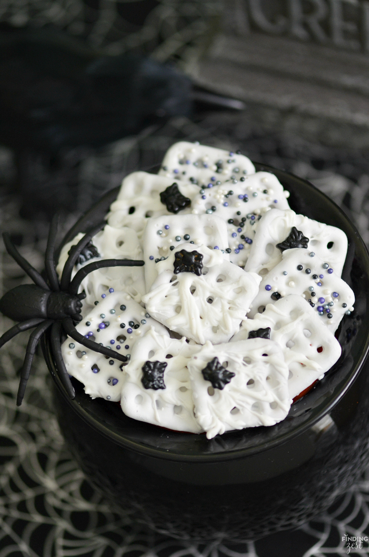 These Halloween chocolate dipped pretzels feature a spooky spider web with spider sprinkles. Only four ingredients are required to make this Halloween treat for kids! Give this fun no-bake dessert a try.