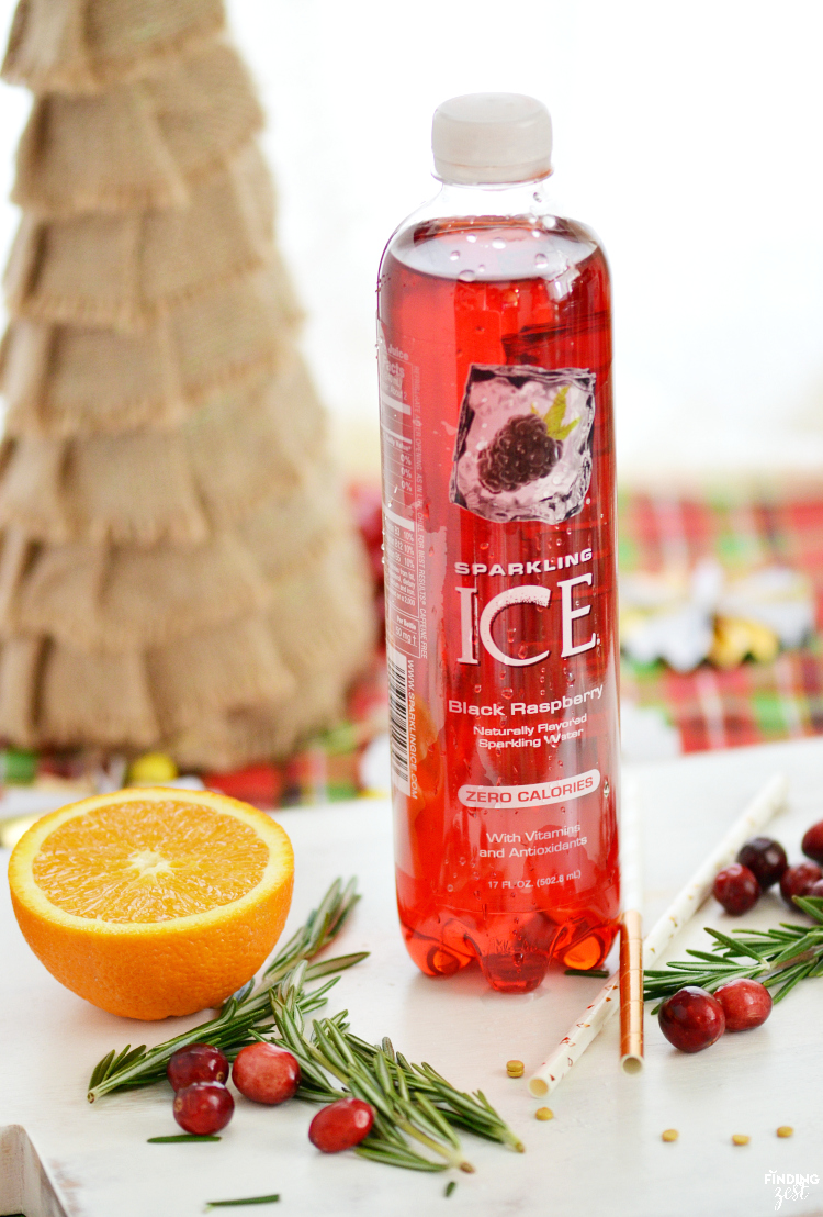Only three ingredients are required to make this Holiday Sparkler cocktail recipe which can easily be made into a mocktail! Add some sparkle to your party with this holiday drink. Garnish with rosemary, cranberries and oranges and a gold confetti rimmed glass for an extra festive look!