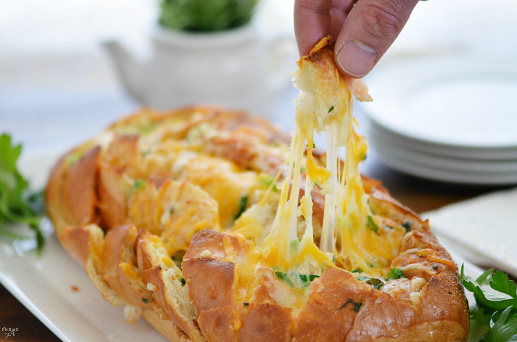 This Cheesy Bacon Pull Apart Bread is the perfect appetizer for your holiday entertaining or game day! This easy to make bread will be a hit with guests!