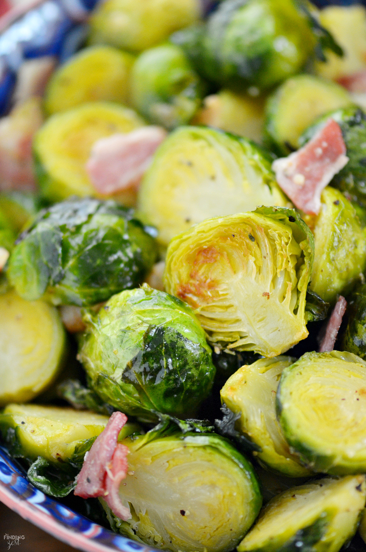 Wonder how to cook brussel sprouts that taste amazing? These oven roasted brussel sprouts with bacon are to-die-for and use a simple kitchen hack to make it even easier! Your family will love this vegetable side dish loaded with flavor!