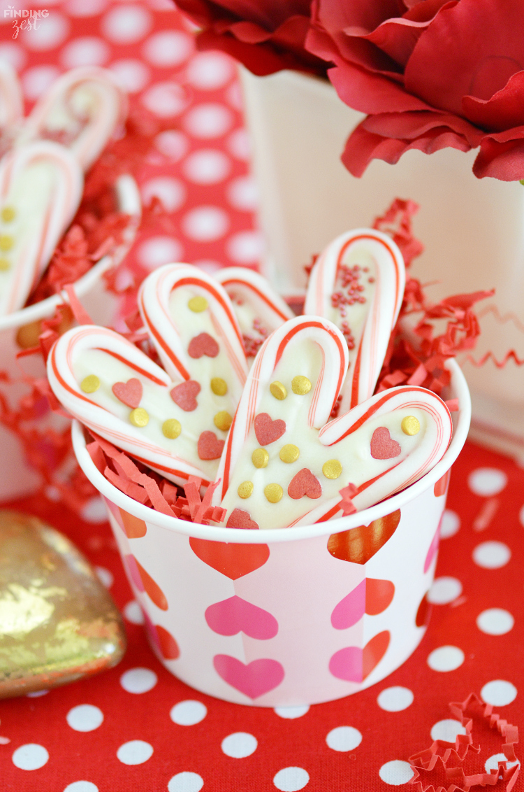 Learn how easy it is to create candy cane hearts, a perfect Valentine's Day treat! Featuring colorful sprinkles, these candy cane hearts with white chocolate are a fun project to make with your kids. If you have ever wondered what to do with leftover candy canes, these treats are for you!