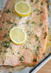 This baked steelhead trout recipe is an easy dinner option and a great alternative to salmon! Loaded with fresh Parmesan cheese, fresh parsley, lemon and garlic, it is sure to become one of your favorite baked fish recipes!