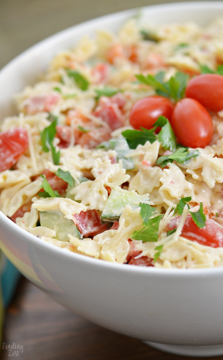 This creamy bowtie pasta salad is loaded with veggies and flavor but is a super easy pasta salad recipe! Serve this cold pasta salad at your next family get together. Works great for summer cookouts and potlucks. With this pasta salad with no mayo, keep guests guessing on what makes this creamy dressing so amazing!