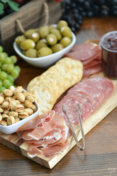 Learn how to make a mini charcuterie board, perfect for feeding a smaller crowd. Save money and time with a simpler version of this classic starter including cured meats, nuts, olives and more. You'll fall in love with this last minute appetizer idea!